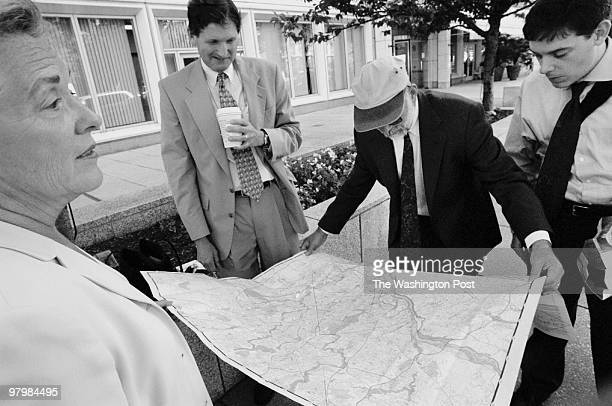 TERROR In the wake of multiple terrorist attacks on the US Pictured federal employees evacuated from the New Executive Office Building consult a map...