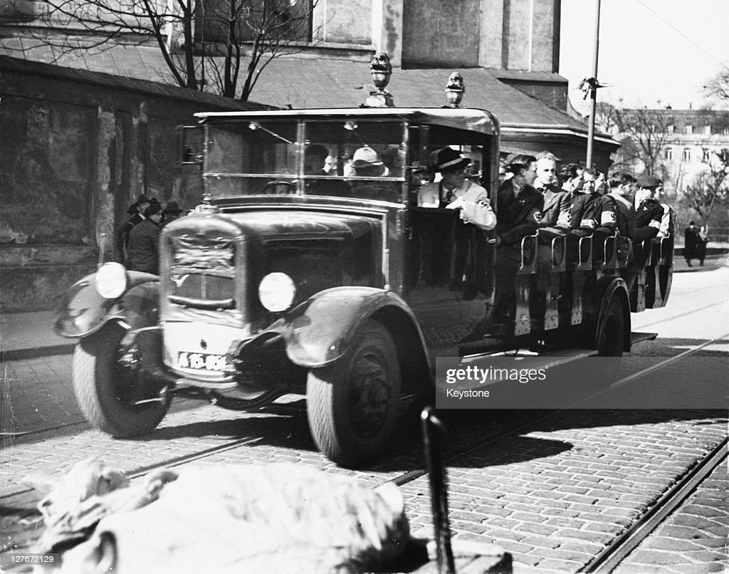 In the wake of the Anschluss, or Nazi-takeover, of Austria, a group of Austrian Nazis tours Vienna in a charabanc, seeking to attack Jewish-owned businesses in the city, 1938.