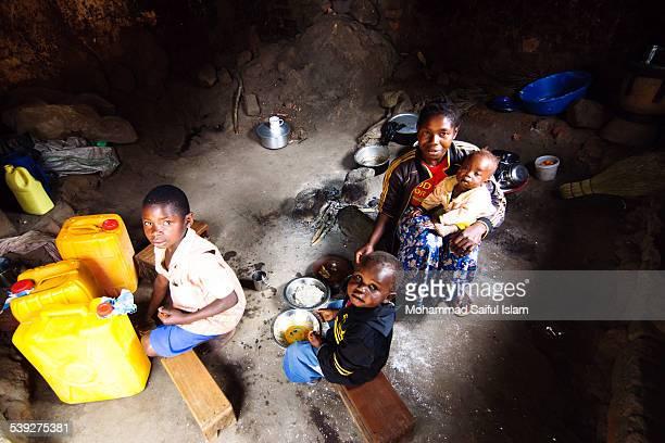 In the war torn D R Congo a mother was feeding her children inside a broken building.