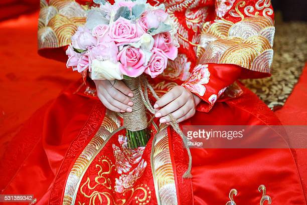In the wedding the bride holding flowers