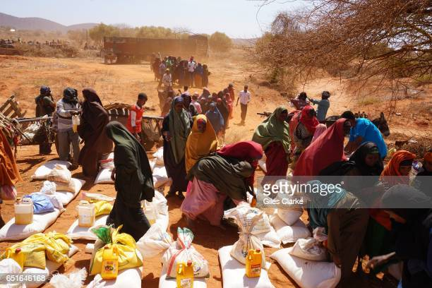 In the western desert town of Dinsoor newly arrived drought victims rush toward food supplies delivered by the UN's World Food Program According to a...