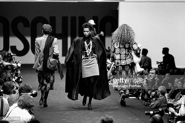 In the winter collection fashion show of the famous fashion designer Franco Moschino, some models on the catwalk wear elegant and unique items of...
