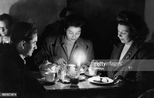 In the winter of 1946 1947 the UK experienced several cold spells beginning on 21 January 1947 Our Picture Shows Tea by candlelight in a City of...