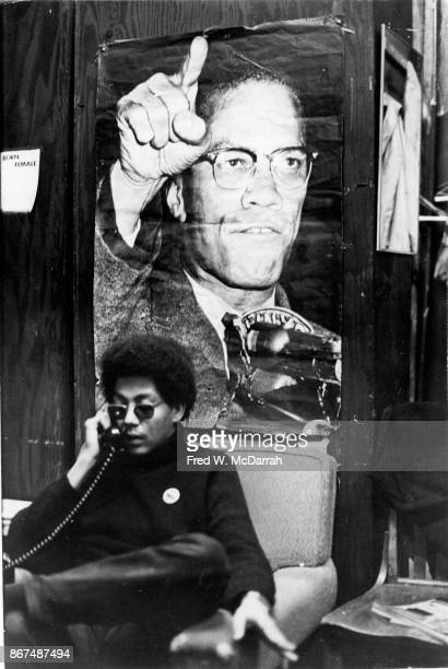 In the Young Lords political headquarters Minister of Information Pablo 'Yorba' Guzman talks on the telephone beneath a poster of Malcolm X New York...
