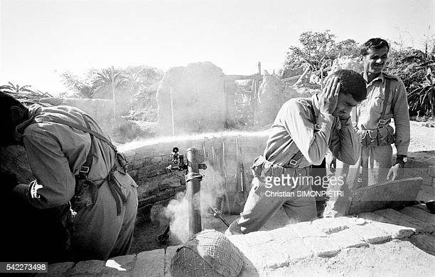 In their fortified camp Pakistani soldiers await the attack of Indian paratroopers and their mortar bombings