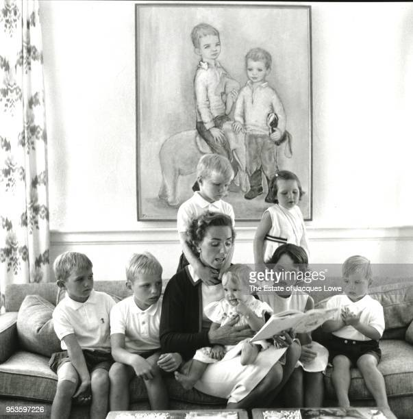 In their home Hickey Hill Ethel Skakel Kennedy reads to a her children as they all sit on a sofa McLean Virginia early 1960s Pictured are seated from...