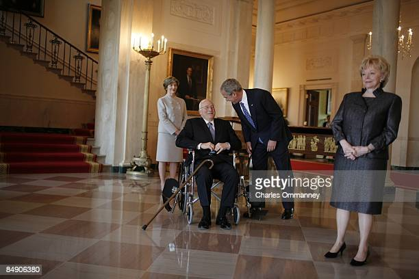 In their last moments in the White House President George W Bush first lady Laura Bush Vice President Dick Cheney and his wife Lynn await the arrival...