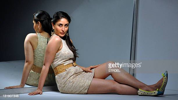 In these photographs released on November 8 Indian Bollywood actress Kareena Kapoor poses on the set of an advertising photographic session in Mumbai...