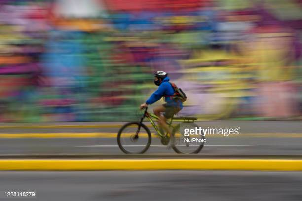 In these times of pandemic you can see much more use of personal transport, such as bicycles. Picture taken with slow shutter speed, in Santiago,...