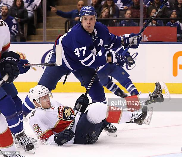 In third period action, Toronto Maple Leafs center Leo Komarov dumps Florida Panthers defenseman Michael Matheson and keeps his eye on the puck. The...