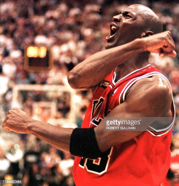 In this 14 June 1998 file photo Michael Jordan of the Chicago Bulls celebrates after winning game six of the NBA Finals against the Utah Jazz at the...