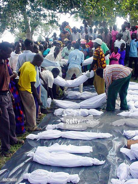 In this 15 June 2005 photo officials from Obalanga subcounty prepares 46 bodies that were exhumed from the surrounding bushes for decent burial The...
