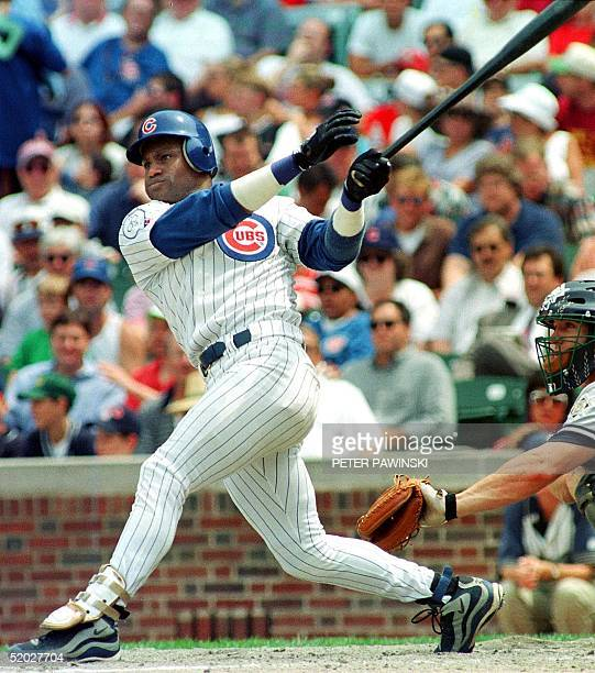 In this 17 June file photo Chicago Cubs outfielder Sammy Sosa blasts his 25th home run of the year during the fourth inning of their game with the...