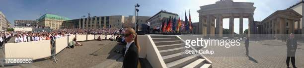In this 180 degree panorama photo people sitting under a blistering sun on Pariser Platz square listen to US President Barack Obama speak at the...