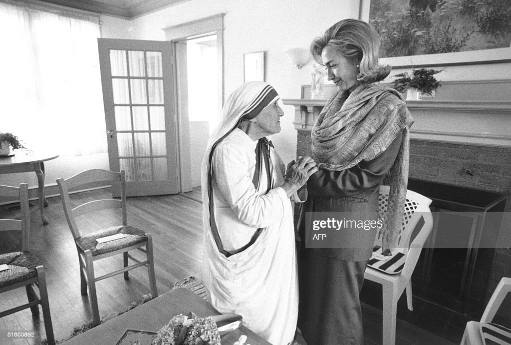 In this 19 June 1995 file photo released by the White House, First Lady Hillary Rodham Clinton meets with Mother Teresa at the opening of the Mother Teresa Home for Infant Children 19 June 1995 in Washington. The White House announced 08 September that Hillary Clinton will attend the funeral for Mother Teresa who died 05 September. AFP PHOTO/THE WHITE HOUSE