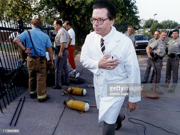 In this 1992 file photo Dr George Tiller walks outside of his abortion clinic in Wichita Kansas after four people locked themselves to the entrance...