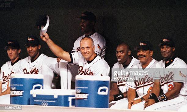 In this 20 September 1998 file photo, Baltimore Orioles third baseman Cal Ripken Jr. Tips his hat to the New York Yankees players who joined fans at...