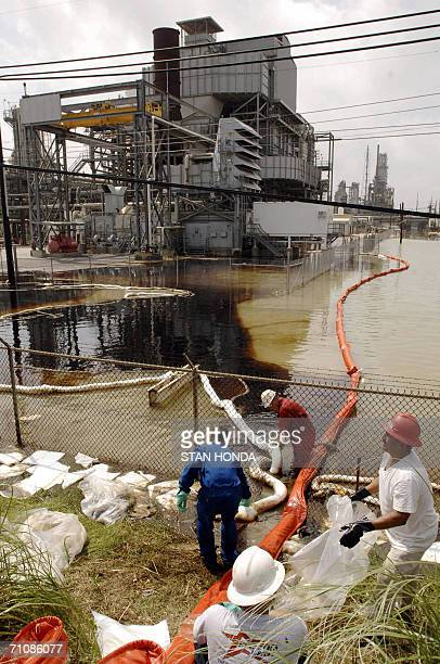 In this 25 September file photo workers from the Garner spill response cleaning company contain an oil spill at the idle Valero oil refinery in Port...