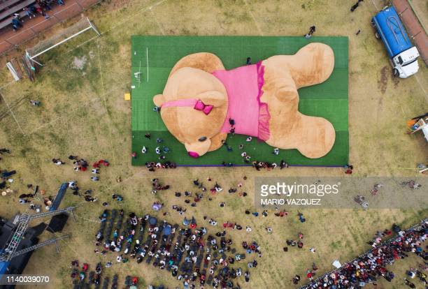 TOPSHOT In this aereal view officials measure a giant teddy bear measuring more than 20 meters long and 4 tons of weight which entered the Guiness...