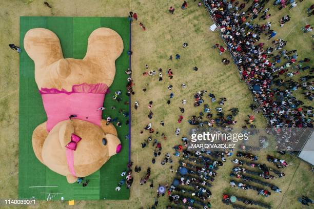 In this aereal view officials measure a giant teddy bear measuring more than 20 meters long and 4 tons of weight which entered the Guiness Book of...
