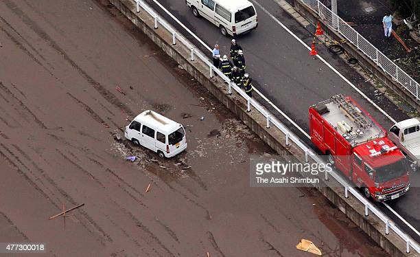 In this aerial image, a car blown off by a strong winds from a road is seen in a paddy on June 15, 2015 in Isesaki, Gunma, Japan. The blustery winds...