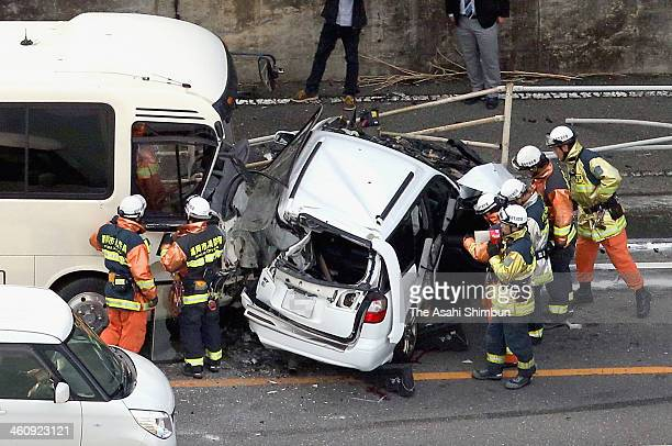 In this aerial image a car is seen crashed by a bus on January 5 2014 in Fukuoka Japan As of January 6 one of men on the car has been killed and...