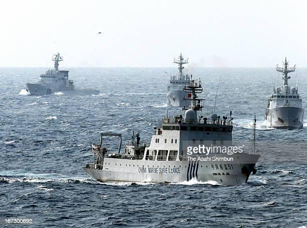 In this aerial image a China Marine Surveillance vessel cruises with Japan Coast Guard ships near the disputed Senkaku Islands on April 23 2013 in...