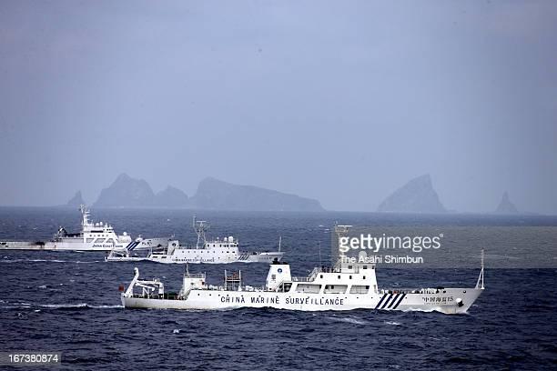 In this aerial image a China Marine Surveillance vessels cruises with a Japan Coast Guard ship near Kita kojima and Minami kojima of the disputed...