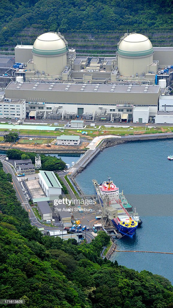 In this aerial image, a container of mixed oxide (MOX) fuel is unloaded from a freighter at Kansai Electric Power Co Takahama Nuclear Power Plant on June 27, 2013 in Takahama, Fukui, Japan. Protesters oppose outside the plant as this is the first shipment of MOX fuel since the meltdowns at the Fukushima No. 1 power plant arrived in Japan, which plutonium stockpile is already equivalent to 5,000 Nagasaki-type atomic bombs.