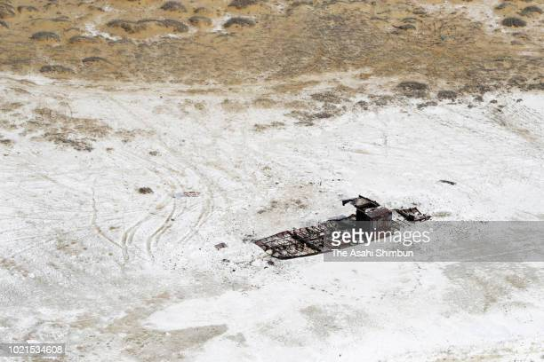 In this aerial image a corroded wrecked ship is seen at saltcovered exposed seabed of the Aral Sea on April 21 2018 in Kazakhstan The Aral Sea used...