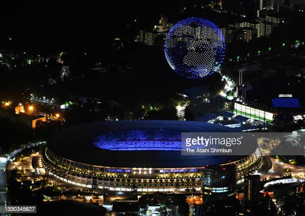 In this aerial image, a drone display is seen over the top of the stadium during the Opening Ceremony of the Tokyo 2020 Olympic Games at Olympic...