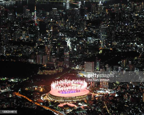 In this aerial image, a general view outside the stadium as fireworks are let off during the Opening Ceremony of the Tokyo 2020 Olympic Games at...