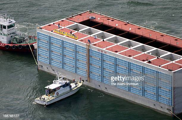 In this aerial image a giant caisson is towed by tugboats at IHI's Aichi factory on May 15 2013 in Chita Japan The Caisson 50meterlong 203meterwidth...