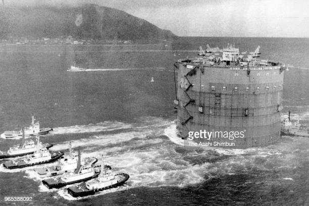 In this aerial image a giant caisson used for the Akashi Kaikyo Bridge is towed on June 9 1989 in Kobe Hyogo Japan