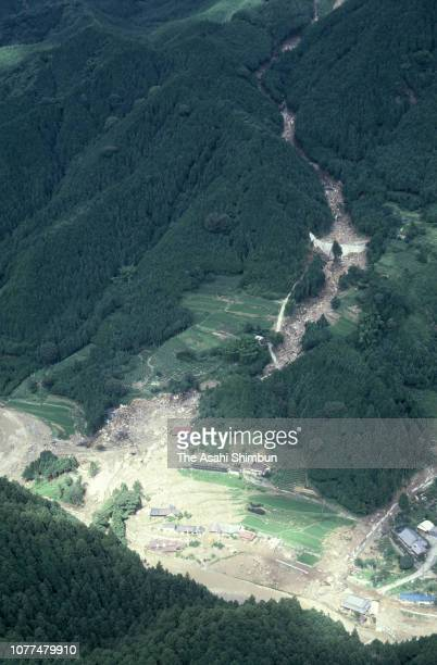 In this aerial image, a landslide site where 9 people are buried is seen after Typhoon Bess hits across Japan on August 2, 1982 in Ureshino, Mie,...
