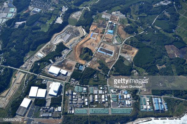 In this aerial image a mid term storage site of the nuclear waste is under construction near the crippled Fukushima Daiichi Nuclear Power Plant on...
