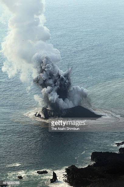 In this aerial image, a newly born volcanic island spews jets of steam and ash off the Nishino Shima Island on November 21, 2013 in Ogasawara, Japan....