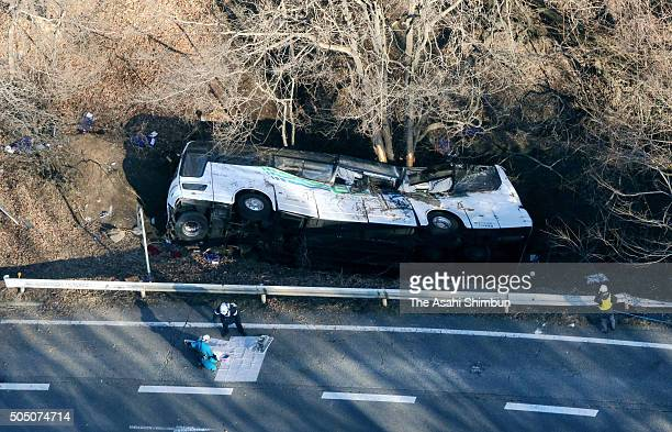 In this aerial image a night ski bus lies at a slope after the accident killing at least 14 people and injuring 27 on January 15 2016 in Karuizawa...
