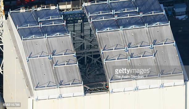In this aerial image a panel is lifted by crane at the No 1 reactor building of the Fukushima Daiichi Nuclear Power Plant on October 31 2014 in Okuma...