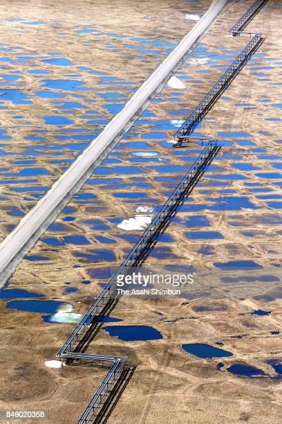 In this aerial image a pipeline from oilfield facilities of Prudhoe Bay Oil Field runs across polygons of permafrost soil on June 18 2017 in Prudhoe...