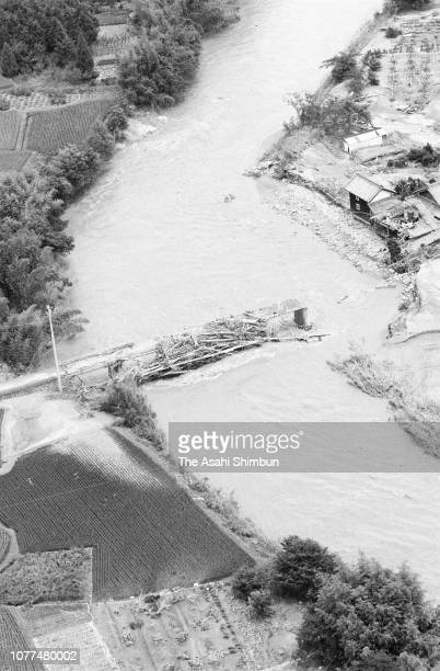 In this aerial image, a river is flooded after Typhoon Bess hits across Japan on August 2, 1982 in Ureshino, Mie, Japan.