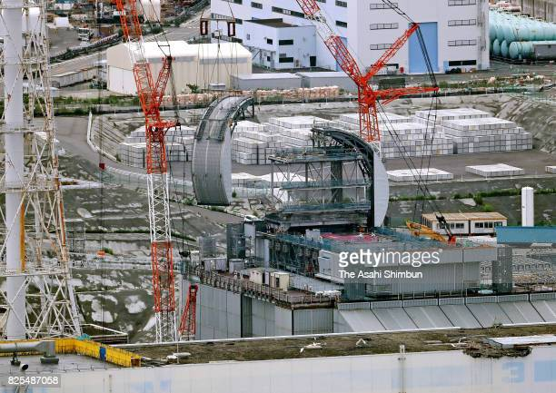 In this aerial image a section of the halftubular shaped roof is installed over the No3 reactor building of the Tokyo Electric Power Co's Fukushima...