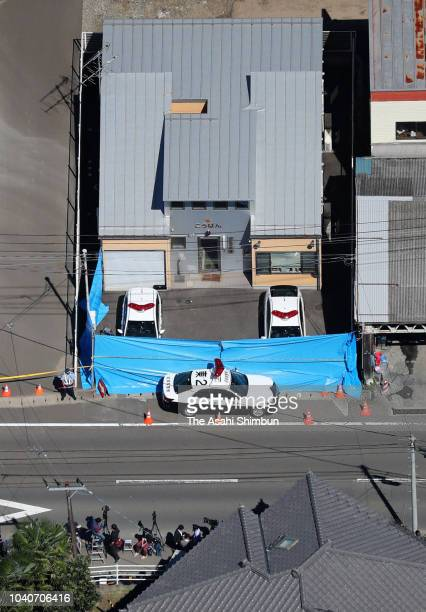 The police box is covered with tarp where a senior police officer was stabbed to death at the HigashiSendai police box and his attacker shot and...
