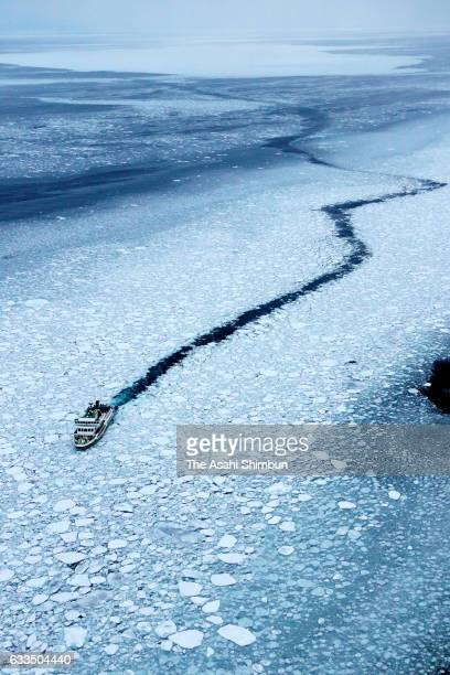 In this aerial image a sightseeing ship cruises among drift ice at Sea of Okhotsk on February 2 2017 in Abashiri Hokkaido Japan Drift ice arrives at...