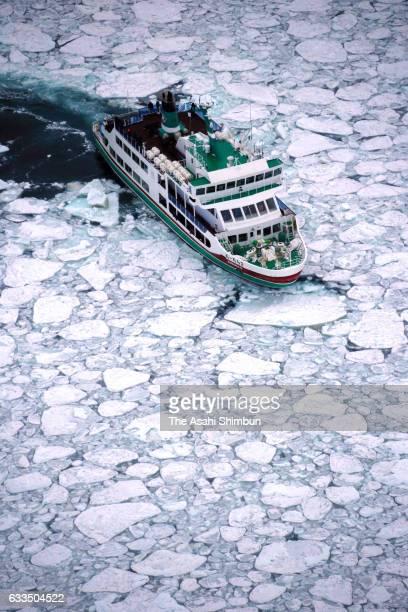 In this aerial image a sightseeing ship cruises among drift ice at Sea of Okhotsk on February 2 2017 in Abashiri Hokkaido Japan Drift ice arrives at...