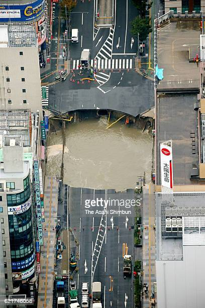 In this aerial image a sinkhole opens up in front of JR Hakata Station on November 8 2016 in Fukuoka Japan The sinkhole was 30 meters long 30 meters...