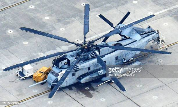 In this aerial image a US CH53 helicopter which window frame fell to a ground of the Futenma Daini Elementary School is seen at the US Marine Corps...