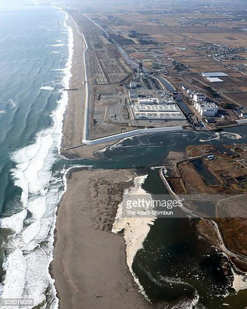 In this aerial image a whirl believed to be created by tsunami after the magnitude74 earthquake hit offshore Fukushima is seen at the river mouth of...