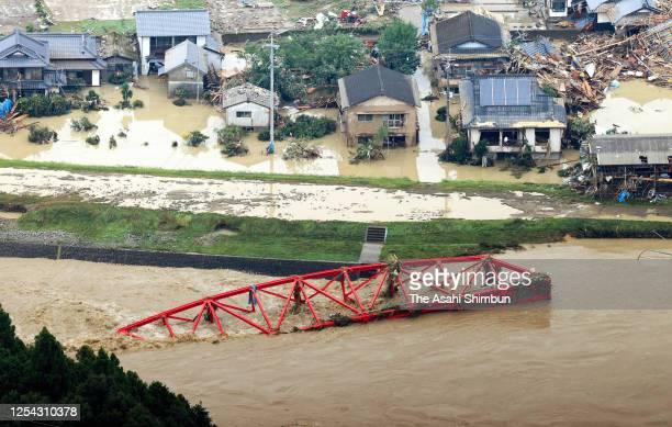 In this aerial image, an iron bridge of Kumagawa Railways is washed away after torrential rains on July 4, 2020 in Kuma, Kumamoto, Japan. 14...