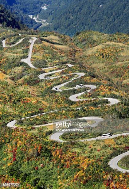 In this aerial image autumn colours begin around Tateyama Kurobe Alpine Route on September 30 2017 in Tateyama Toyama Japan